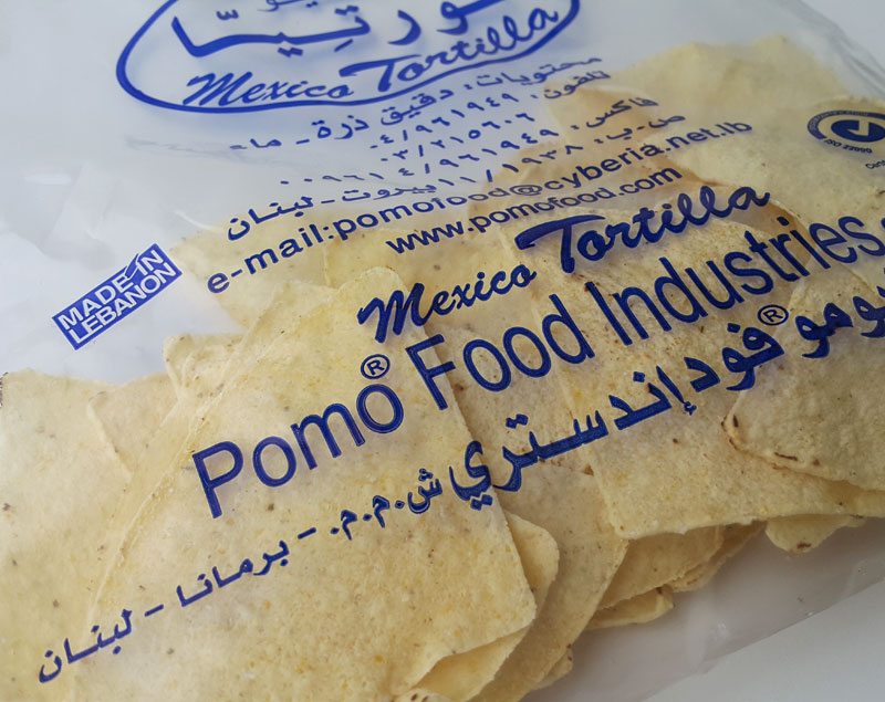 TRIANGLE PRECUT CORN CHIPS - Products POMO FOOD INDUSTRIES